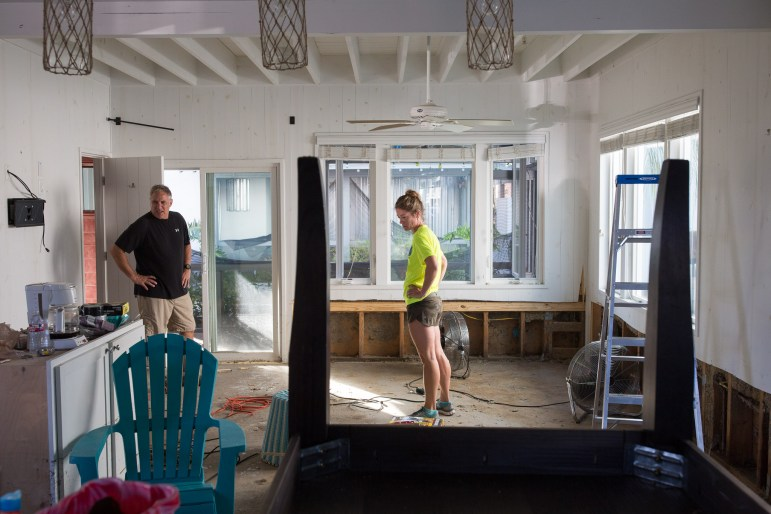 Darrell and Julie Wolle survey the damage to their beachside condo in Port Aransas, Texas. They met in Port Aransas and the tourist heavy town has always been a special place to their relationship.