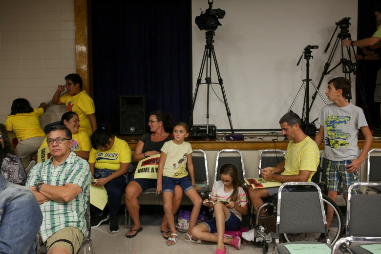 The Torres and Ferguson families in opposition to the NDO arrive early to the SAISD Board Meeting.