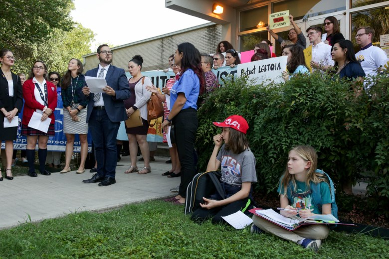 MOVE San Antonio Executive Director Drew Galloway holds a press conference outside the entrance to the SAISD board room.
