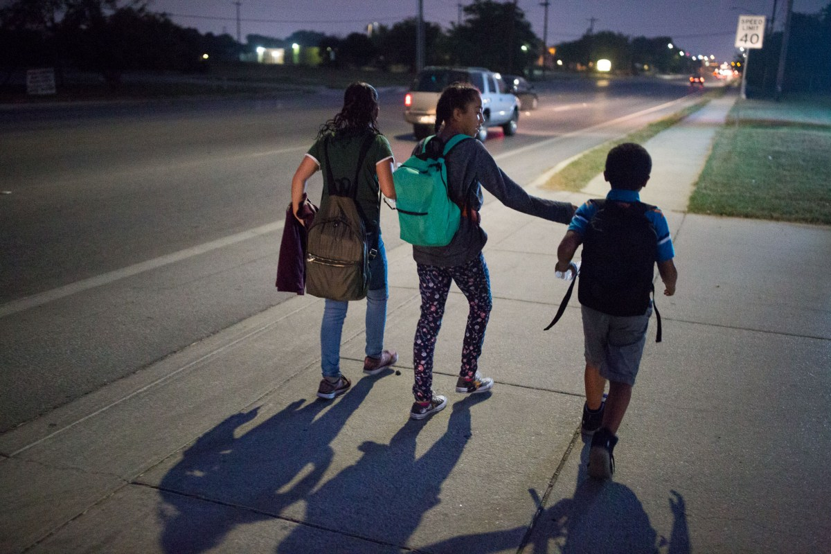 Students of Hutchens middle school Navyih Herrera, Rosalynn Gonzalez, and Chad Herrera, walk along Zarzamora Street during their morning commute.