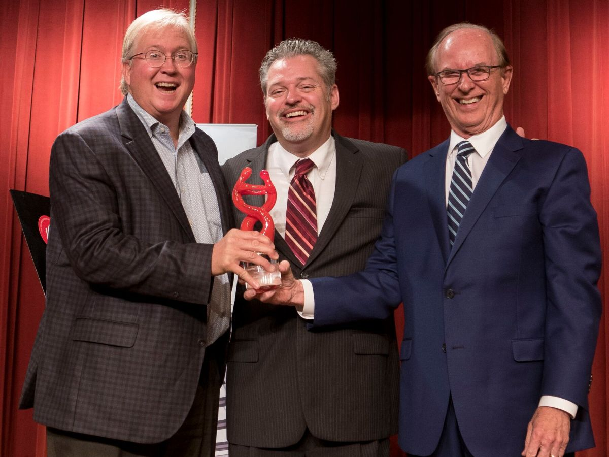 Graham Weston, YOSA Music Director Troy Peters, and County Judge Nelson Wolff pose for a photo honoring Weston's support in the arts of San Antonio.