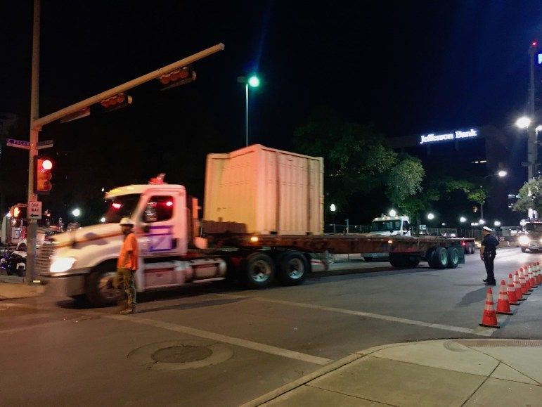 A truck carries equipment to and from Travis Park to assist in the removal of the Confederate monument.