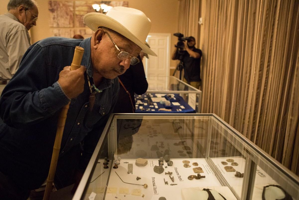 Vincent Huizar views Alamo artifacts\ on display at Alamo Hall.