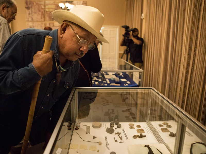 Vincent Huizar views Alamo artifacts\ on display at Alamo Hall.