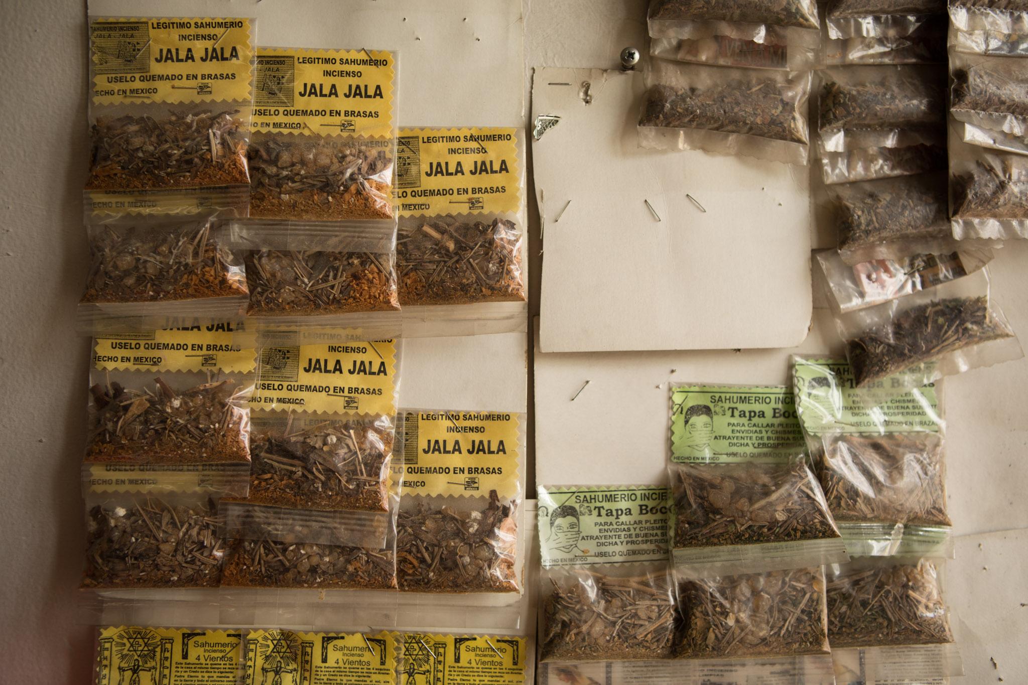 Herbs hang from the walls of Botanica Obadina.