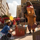 Vincent Allen, 10, wears a dinosaur suit as he stomps through the Calcium Carbonopolis art installation at Chalk It Up.