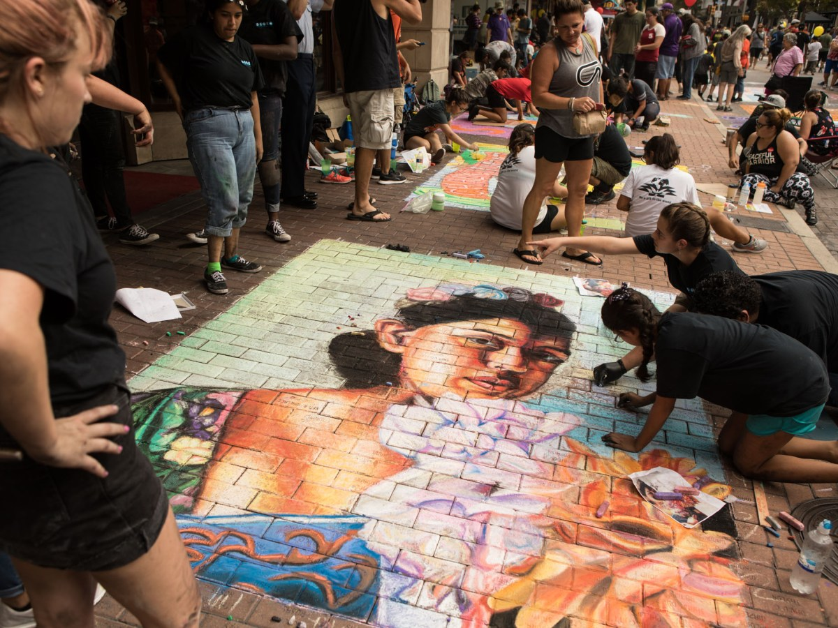 The Blue Star Contemporary MOSAIC Student Artist Program completes a mural in front of La Panaderia at Chalk It Up.