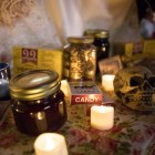 The Floating Day of the Dead Altar is decorated wtih candles, painted backdrops, and traditional Day of the Dead altar materials.