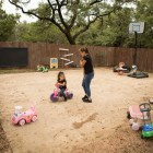 Briana Zapata, 17, (right) plays with her daughter Natalie, 3, outside at SJRC Texas Pregnant Parenting Teen Program.