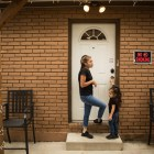Briana Zapata, 17, and her daughter Natalie, 3, stand outside of their home at the SJRC Texas Pregnant Parenting Teen Program.