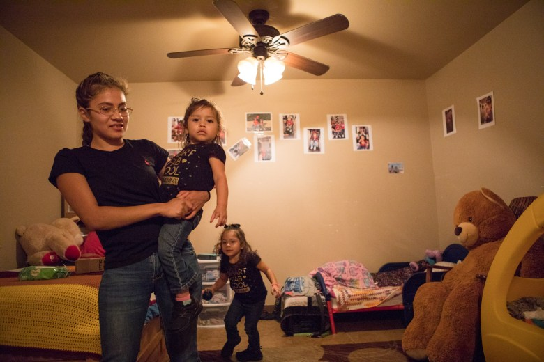 (From left) Briana Zapata, 17, spends time with her daughters Daniella, 1, and Natalie, 3, in their bedroom at the SJRC Texas Pregnant Parenting Teen Program.