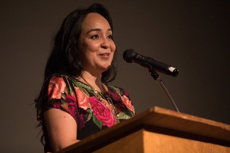 """Guadalupe Theater Executive Director Cristina Ballí speaks before the film screening of """"Santa Muerte: A Folk Saint in Texas"""" at the Guadalupe Theater."""