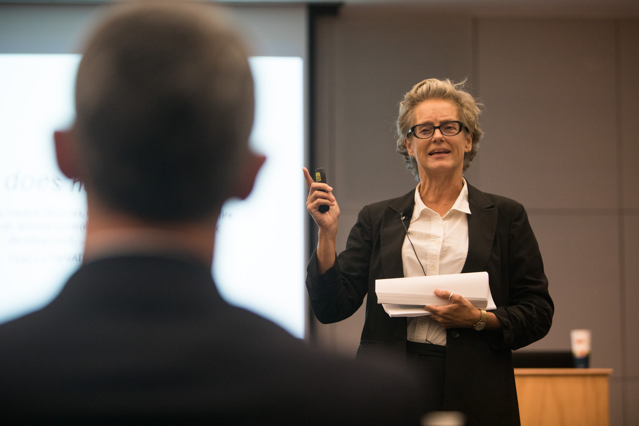 """Trinity University Associate Professor of Sociology and Anthropology Christine Drennon gives a presentation on """"Housing and Neighborhoods through the 'Equity Lens'"""" at the first Mayor's Housing Policy Task Force meeting at San Antonio Central Library."""