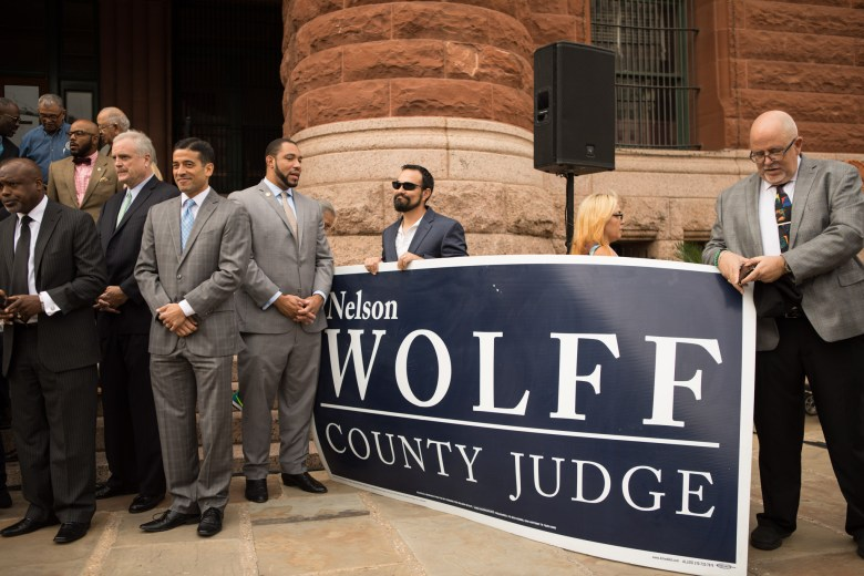 """(Center, from left) Bexar County District Attorney Nicholas """"Nico"""" LaHood and Bexar County Commissioner Tommy Calvert (Pct. 4) stand in support at Bexar County Judge Nelson Wolff's campaign announcement in front of Bexar County Courthouse."""