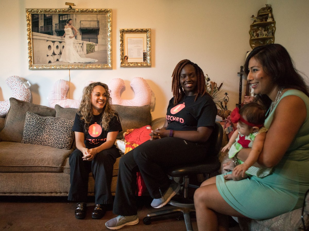 (From left) Latched Breastfeeding founders Ashley Green and Veronica Haywood sit with Angela Mercado and her daughter Zoryan Miko Mercado, 9 weeks. Angela has been breastfeeding her daughter since birth.