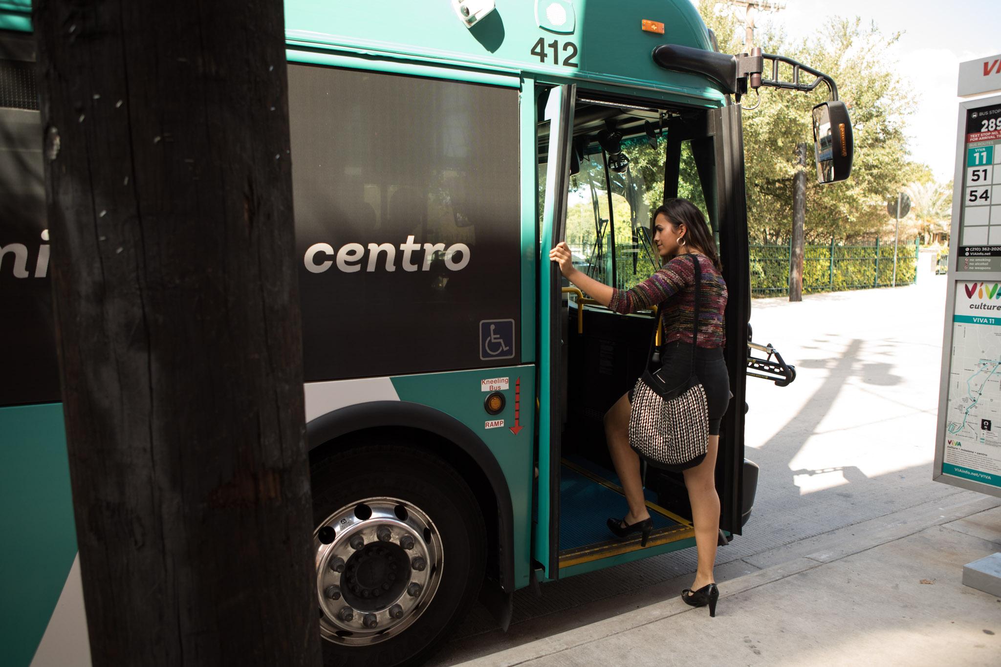 "Celeste Ramirez climbs aboard the VIA VIVA Culture Bus before performing in ""VIA VIVA Cultural Adventure."""
