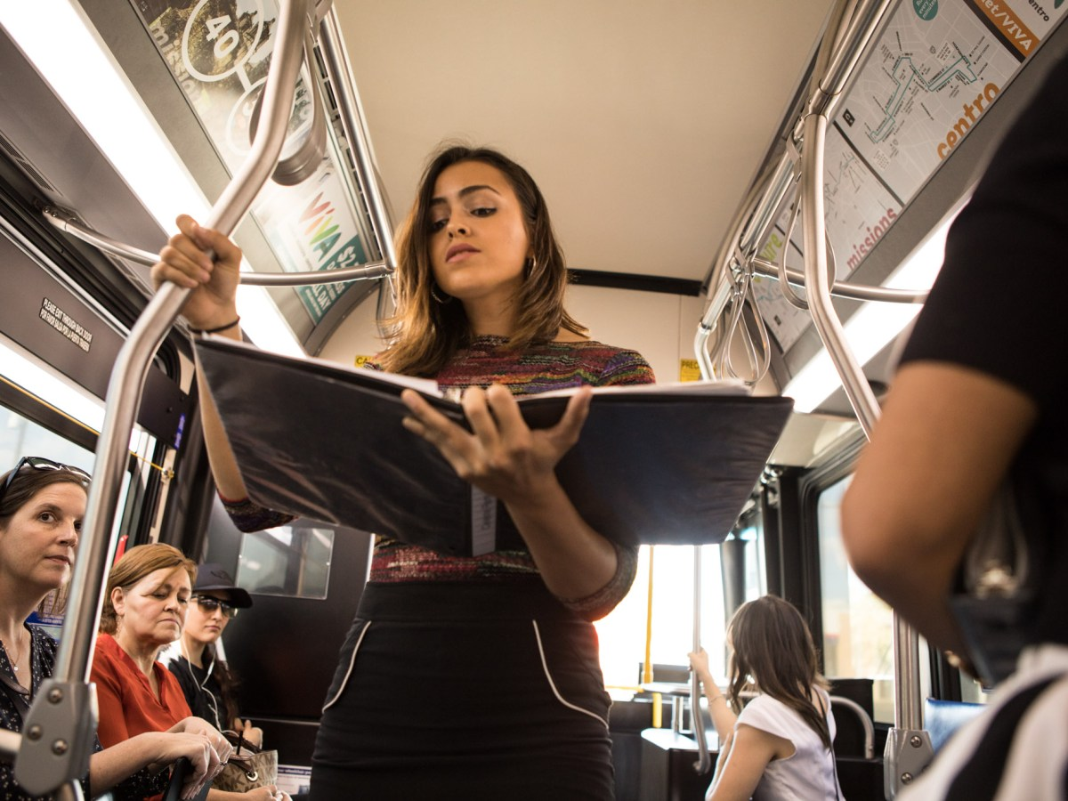 "Celeste Ramirez sings a solo in the performance ""VIA VIVA Cultural Adventure"" aboard the VIA VIVA Culture Bus."