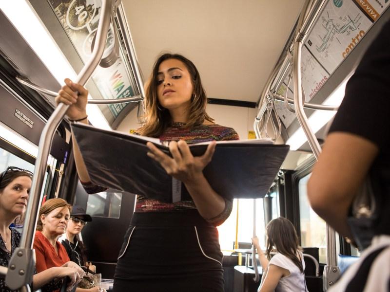 """Celeste Ramirez sings a solo in the performance """"VIA VIVA Cultural Adventure"""" aboard the VIA VIVA Culture Bus."""
