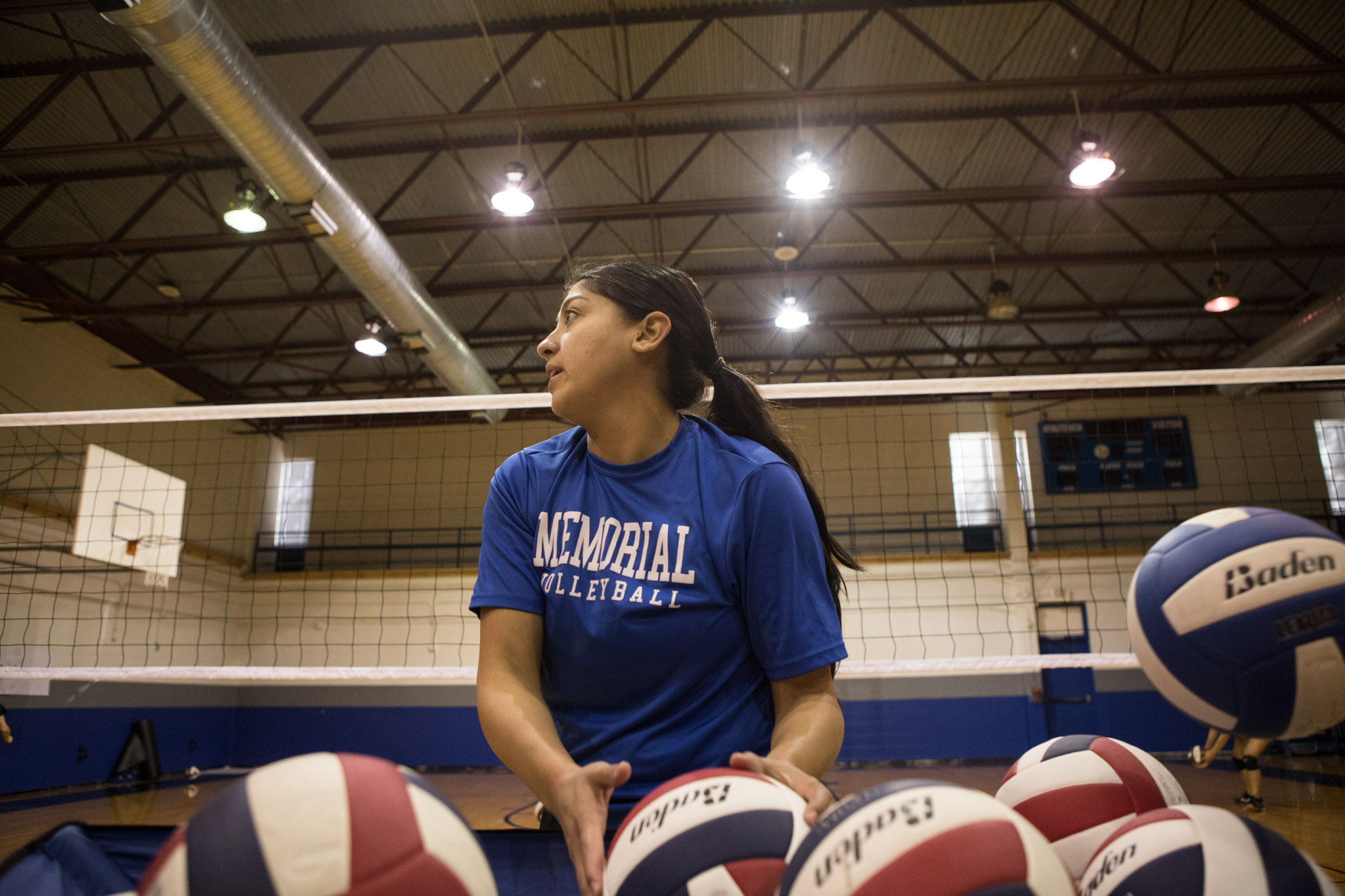 Memorial High School Volleyball Coach Samantha Mendez prepares to throw the ball during practice.