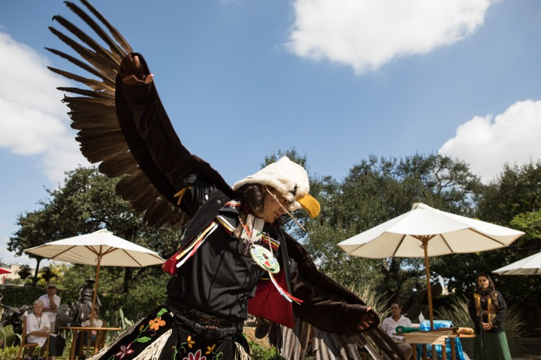 Ty Defoe performs an eagle dance in the McNutt Sculpture Garden at the Briscoe Museum at the 4th Annual Yanaguana Indian Arts Market.
