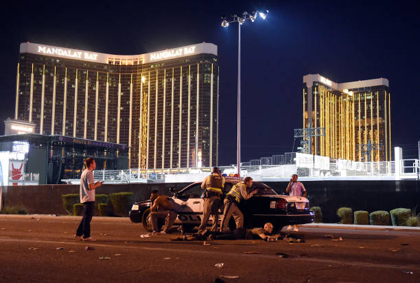 Las Vegas police stand guard along the streets outside the Route 91 Harvest Country music festival grounds of the Route 91 Harvest on October 1, 2017 in Las Vegas, Nevada due to reports of an active shooter around the Mandalay Bay Resort and Casino.