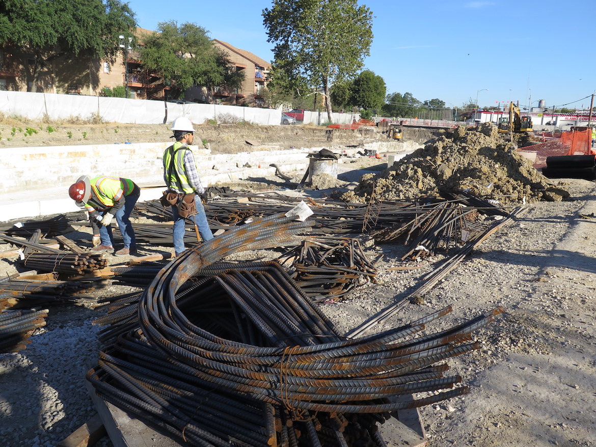 Construction workers along San Pedro Creek continue progress as the project's deadline of May 5, 2018 draws closer.