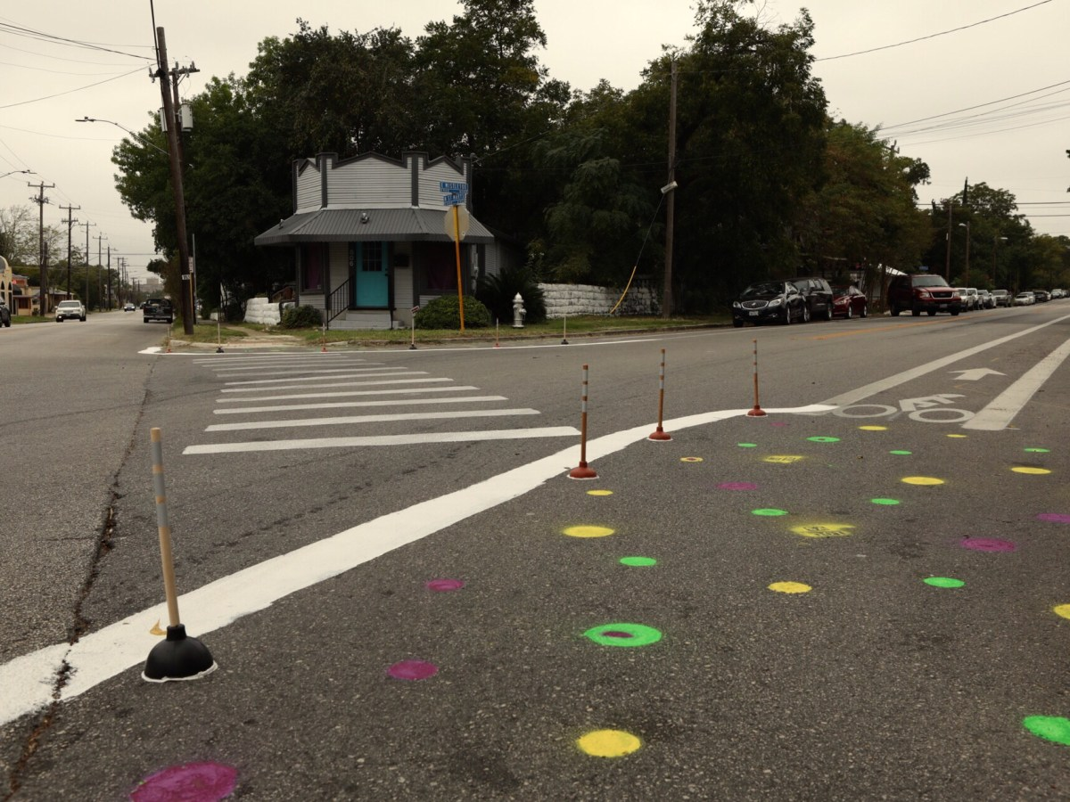 A make shift crosswalk and narrowed street lanes draw praise and criticism from neighbors.