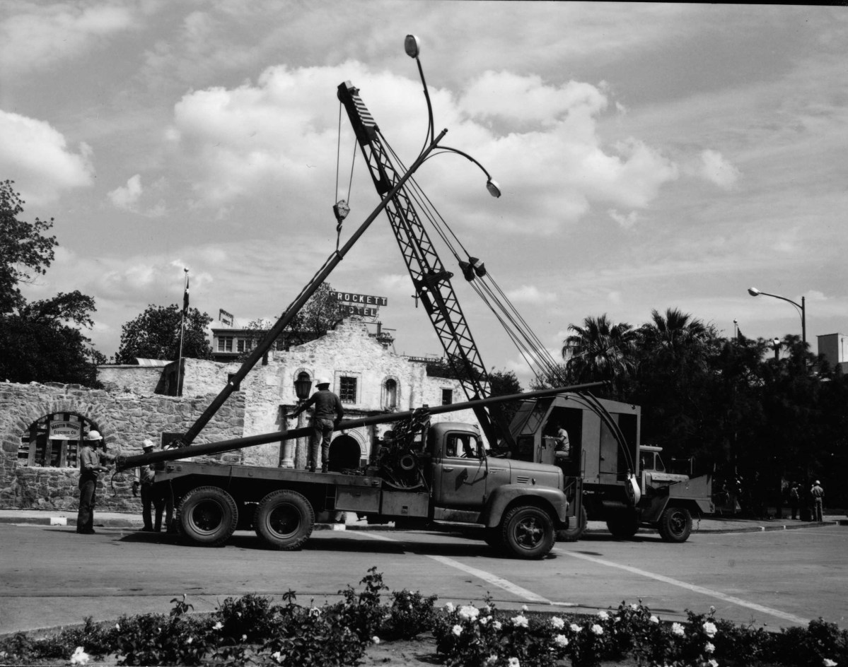 Workers install street lights in Alamo Plaza in the 1940s.