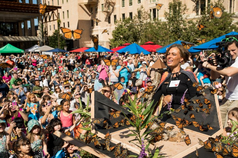 Tagged monarch butterflies are released to a crowd of hundreds at the Pearl.