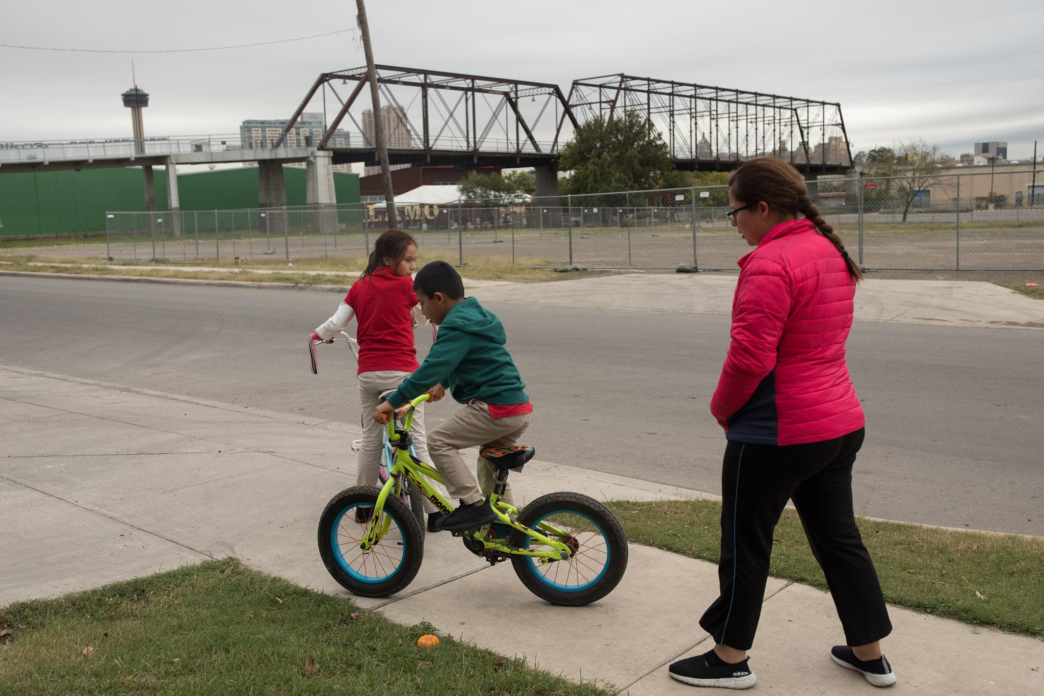 The Martinez family walks towards Hays Street Bridge.