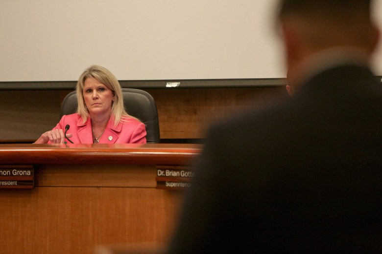 NEISD board President Shannon Grona listens to a student opposing the name change during the NEISD board meeting.