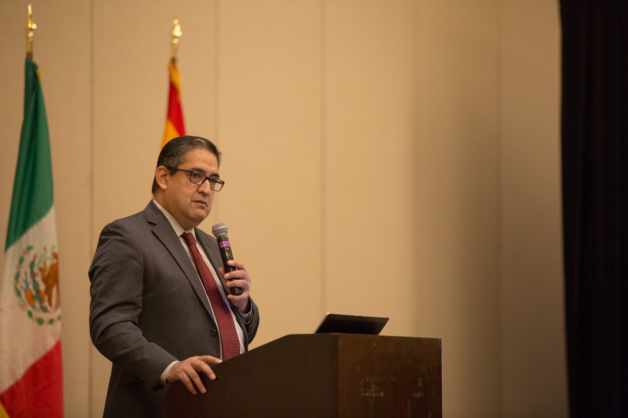 Bexar County Executive Director of Economic Development David Marquez introduces Leila Afas to the stage.