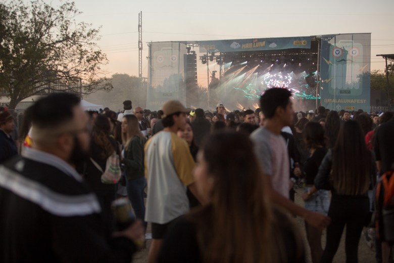 Attendees gather for music at Mala Luna on the grounds of Nelson Wolff Stadium.
