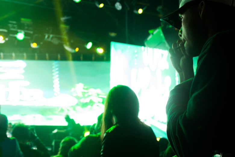 A festival attendee smokes during the Wiz Khalifa performance.