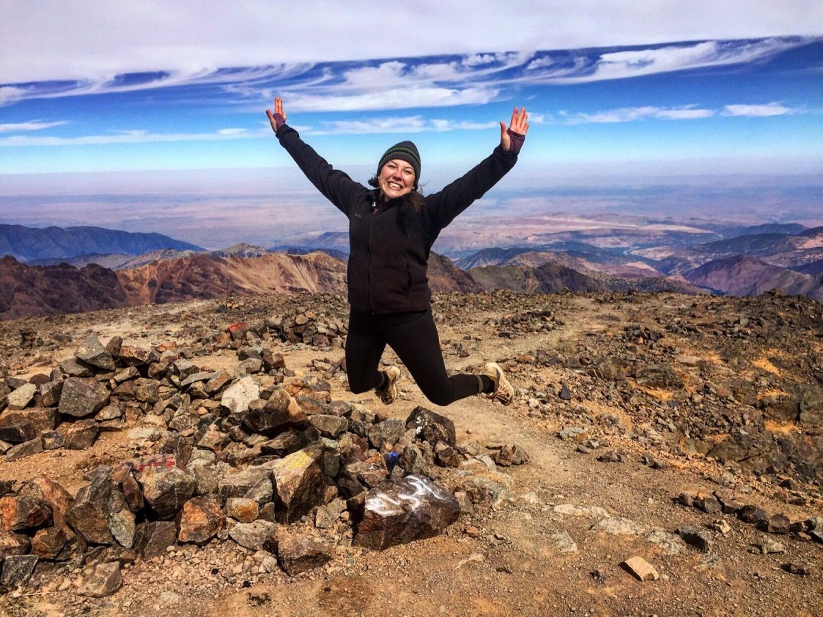 Lauren Bernal jumps at the top of Mount Toubkal, the highest point in the Atlas Mountains and Northern Africa, during her participation in Remote Year.
