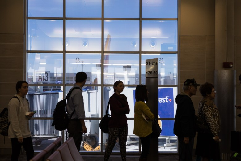 A Southwest airplane is viewed through the window of Terminal A at the San Antonio International Airport on the day before Thanksgiving.