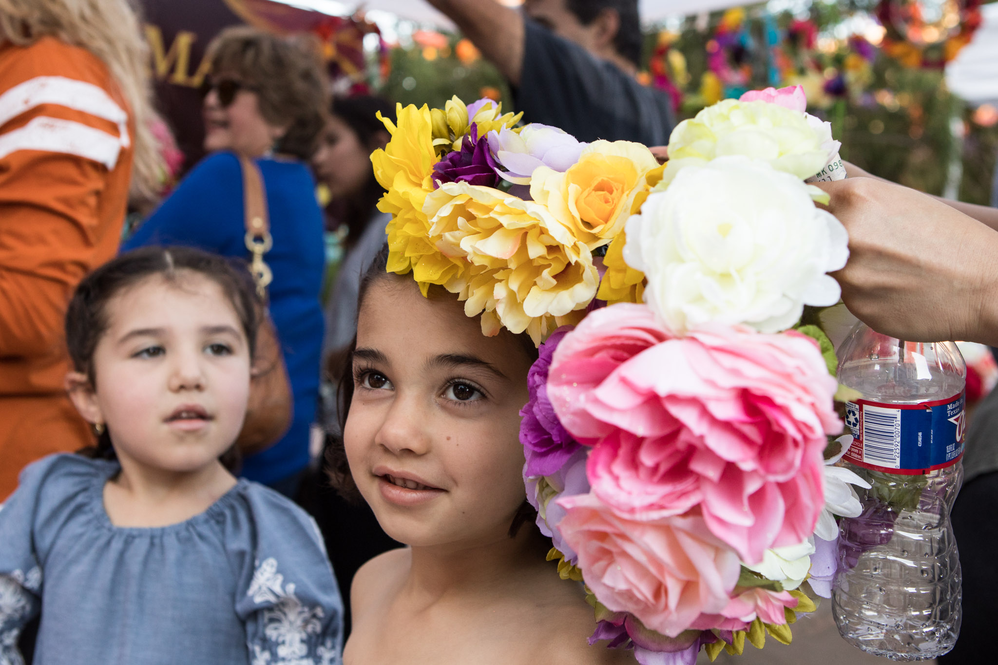 (From left) Jimena Rodriguez Moya, 5, and Isabel Fernandez Moya, 5, try on flower crowns for Día de los Muertos at the Pearl.