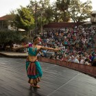 Natyanjali Kuchupudi Dance School dancers perform in front of a large crowd at Arneson River Theatre during Diwali San Antonio: Festival of Lights.