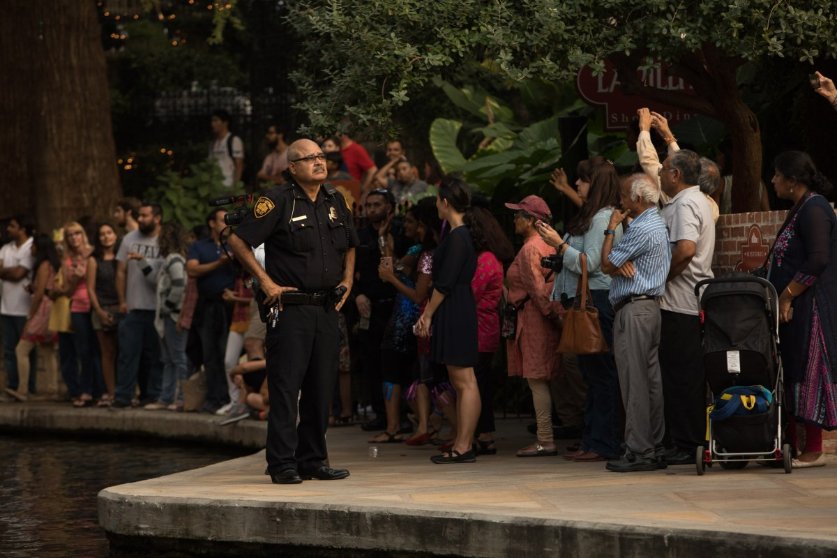 A police officer provides security at Arneson River Theatre stage at Diwali San Antonio: Festival of Lights.