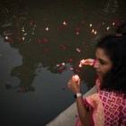 Madhavi Beehram places her candle in the San Antonio River during the Diya Ceremony at Diwali San Antonio: Festival of Lights.