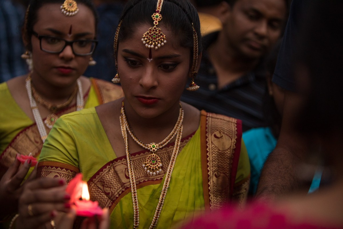 Kaveri Natya Yoga dancers light candles during the Diya Ceremony at Diwali San Antonio: Festival of Lights.