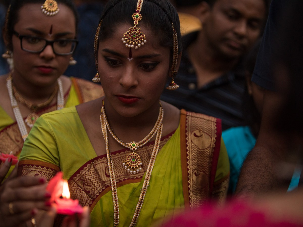 Kaveri Natya Yoga dancers light candles during the Diya Ceremony at Diwali San Antonio: Festival of Lights.