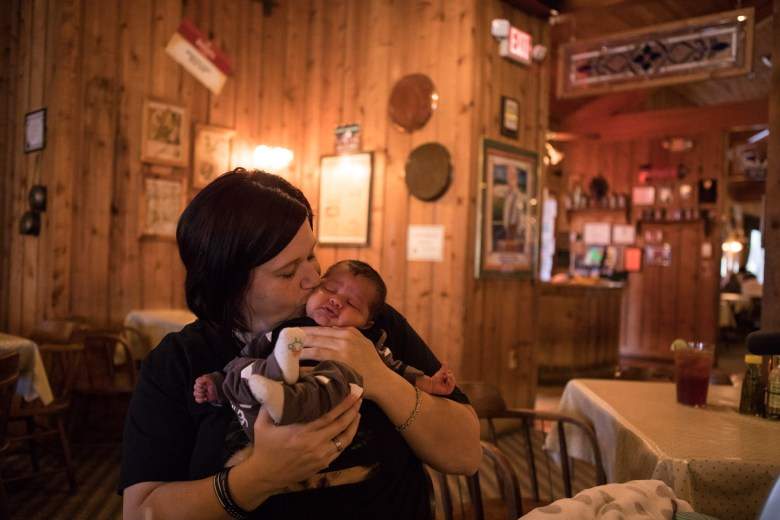 Amber Steele kisses her six-week-old son Chamber while enjoying a lunch at Acadiana Café on Veterans Day.