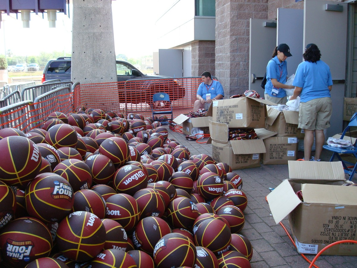 Volunteers inflate a total of 2,500 basketballs for the 2008 Final Four Dome Dribble.