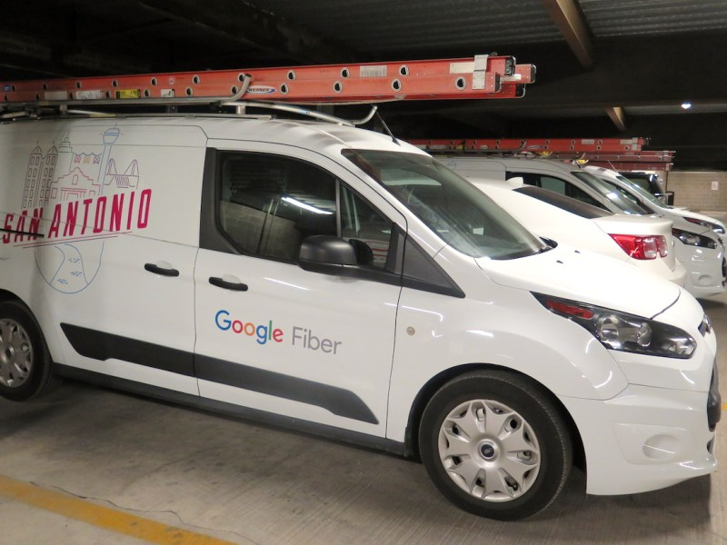 Several Google Fiber vans appeared in the Rand building garage on Tuesday.