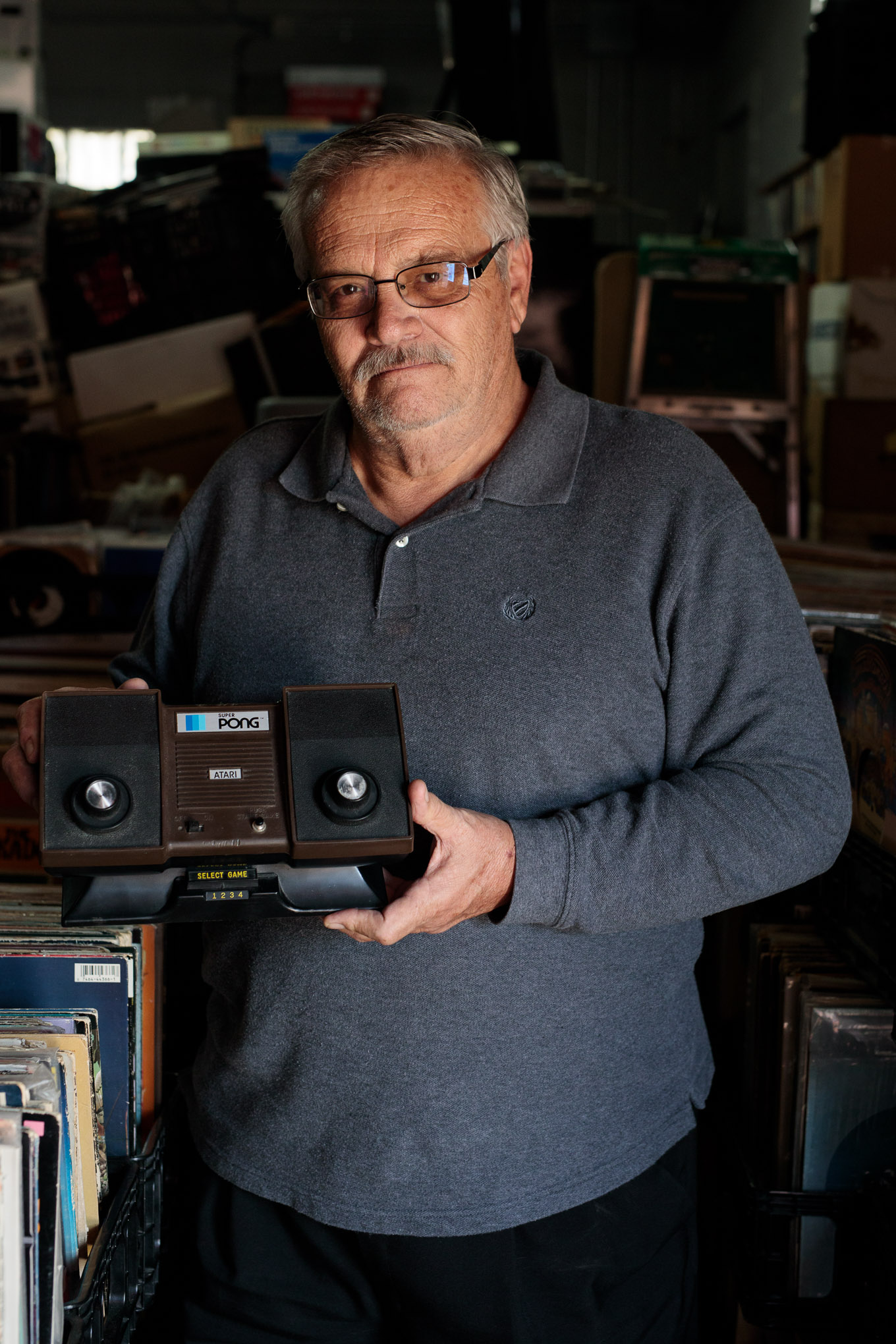 Alejandro Martinez holds an Atari Super Pong Model C-140 unit, the same device he carried around with him to department stores as a young Atari salesman in the seventies.