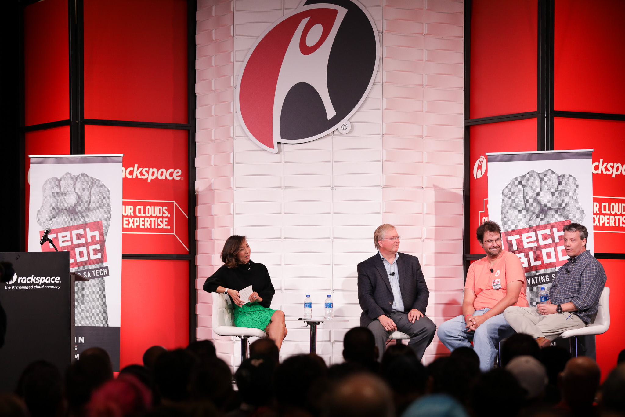 (From left) Rachel Woodson moderates a panel of former Rackspace executives Graham Weston, Dirk Elmendorf, and Lew Moorman.
