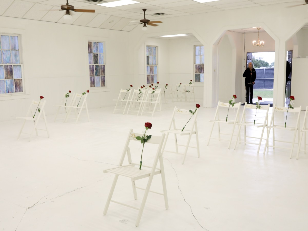 Roses are placed over chairs in memory of parishioners of the First Baptist Church in Sutherland Springs.