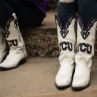Texas Christian University Showgirls wear their TCU boots to support their team at the Rudy's Bar-B-Q Pep Rally.
