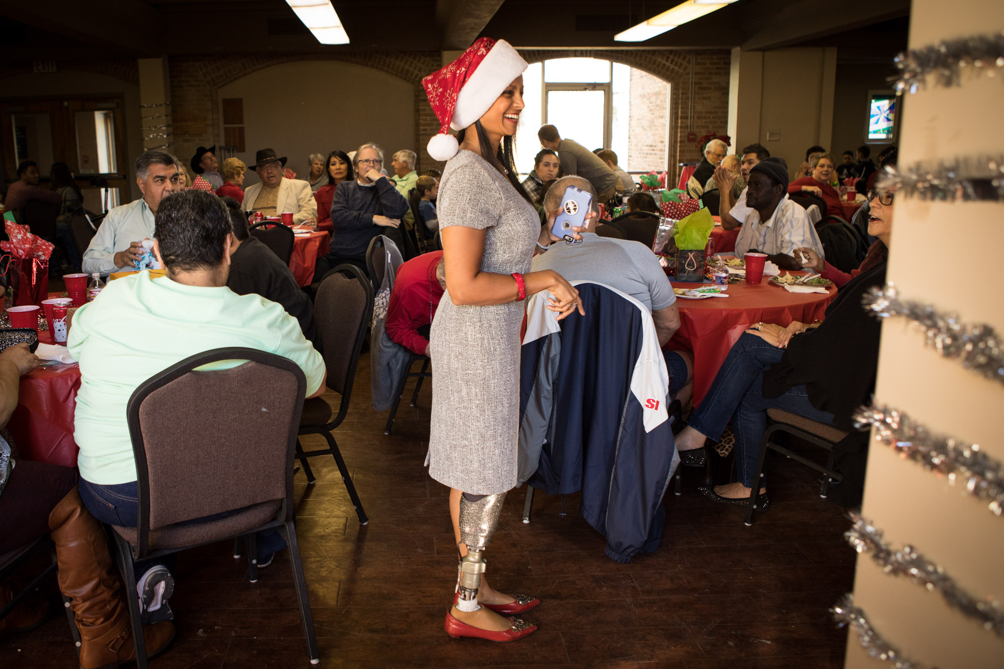 San Antonio Amputee Foundation Founder and Executive Director Mona Patel leads the gift exchange at the San Antonio Amputee Foundation Annual Holiday Luncheon.
